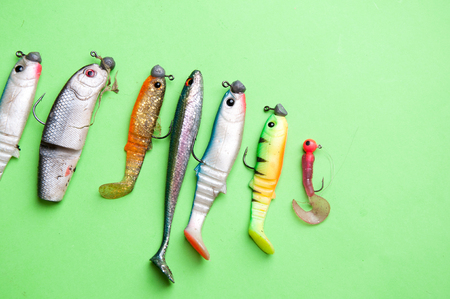 Artificial fish, fishing equipment on a green background