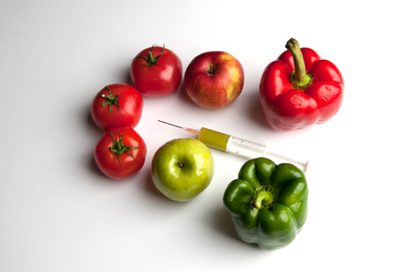 Vegetables and fruits infected GMO. Stock Photo