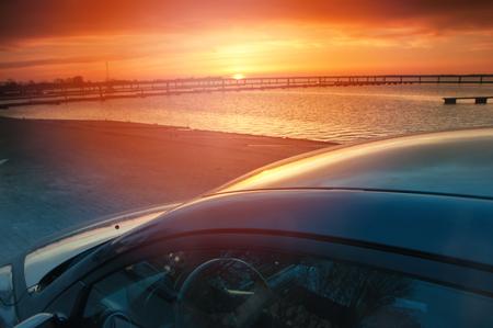 Car at sunset Stock Photo