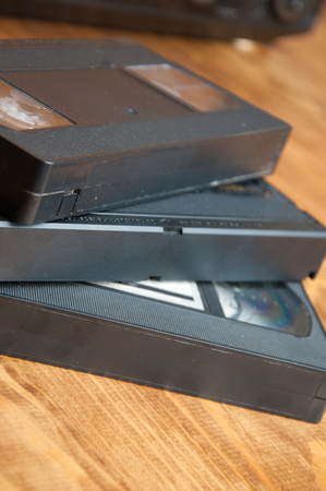cassettes: cassettes on a wooden table