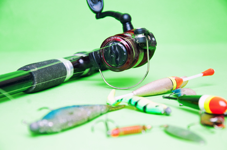 fishing equipment: Fishing equipment on a green background.