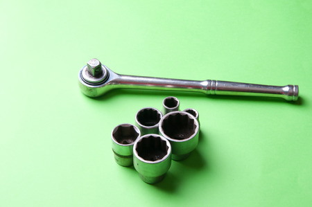 daily grind: The image of tools on a green background. Stock Photo