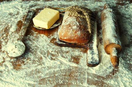 additions: Bread and additions on a wooden table.