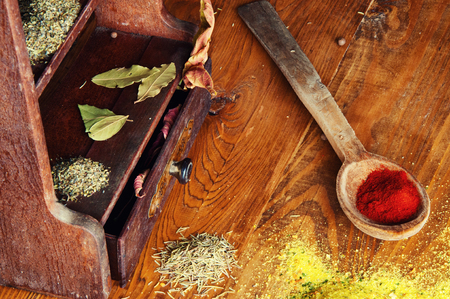 Spices lying on a small cabinet. Stock Photo