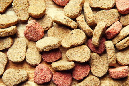 The image of dog food on a wooden table. Stock Photo