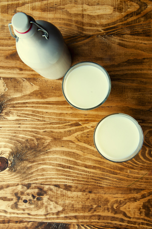 pouring milk: .Pouring milk into a glass.