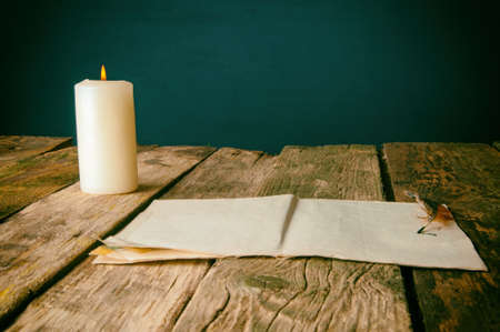 white candle: The old studio writer on a wooden background.