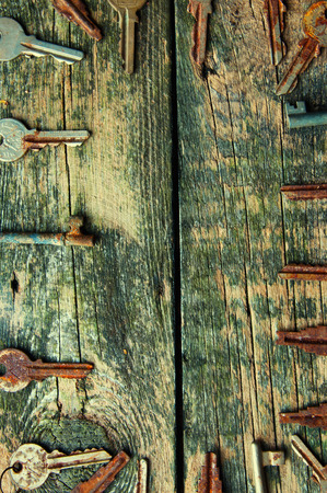 door lock love: The keys on old wooden background from above.