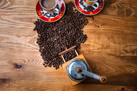 The concept of coffee on a brown wooden table.