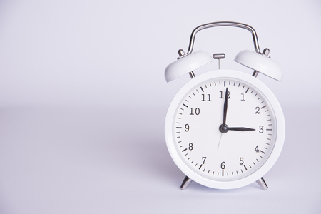 clock with the twelfth hour on a white background.