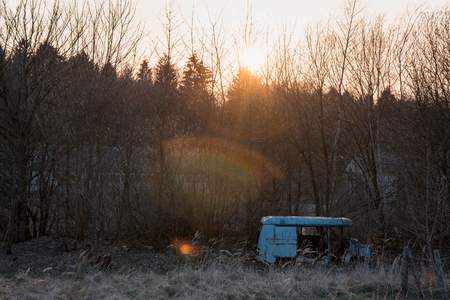 old destroyed abandoned bus during sunset beautiful sunset Foto de archivo