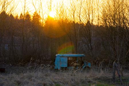 old destroyed abandoned bus during sunset beautiful sunset Stock Photo