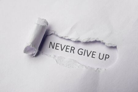 Never give up on white Torn Paper. Copy space.