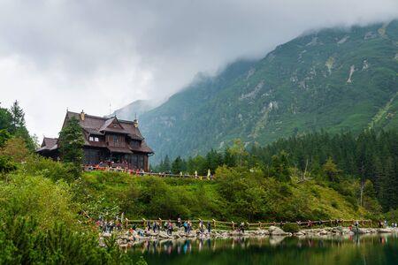 Wooden cabin next to the sea eye in the Tatras. Фото со стока