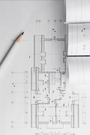Architect rolls and architectural plan,technical project drawing.