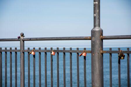 Padlocks on the railings at the pier in Miedzyzdroje. poland.