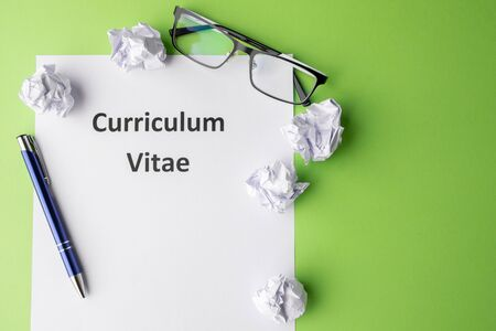 "The inscription ""Curriculum vitae"" On a sheet of paper. Green background."