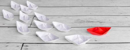 Leadership concept using red paper ship among white Stock fotó