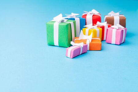 Colorful gifts on blue background. Perfect for Christmas