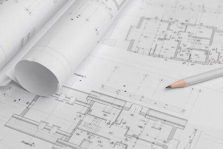 Architektenrollen und Architekturplan, technische Projektzeichnung.