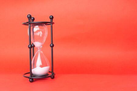 Transparent hourglass, Blue background. Copy, text space. Reklamní fotografie