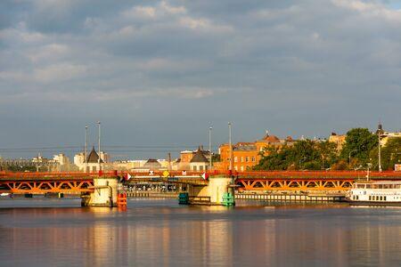 Red metallic bridge (Dlugi bridge or Long bridge) across the Oder river, Szczecin, Poland