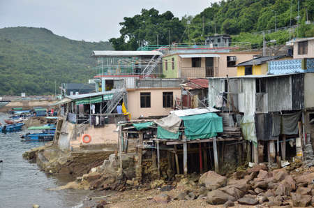 literally: Houses on stilts above the tidal flats of Lantau Island are homes to the Tanka people in Tai O, Hong Kong These unusual structures are interconnected, forming a tightly knit fishing community that literally lives on the water for generations