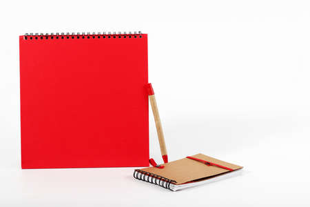 elastic band: notebook and pen isolated on white background
