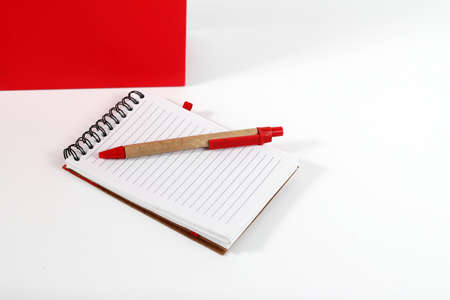 empty pocket: notebook and pen isolated on white background