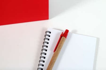 moleskin: notebook and pen isolated on white background