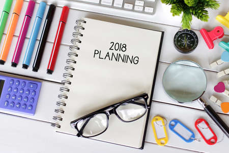 Top view notebook writing 2018 Planning