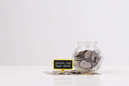 Money,coins in glass jar and saving concept Stock Photo