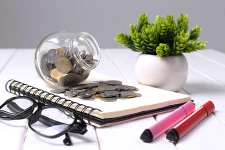 Money,coins in glass jar and saving concept Reklamní fotografie