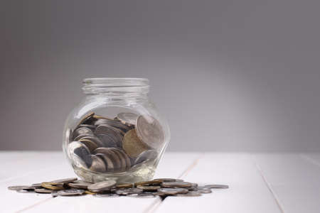 Money,coins in glass jar for saving concept