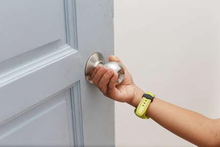 hands holding the door knob