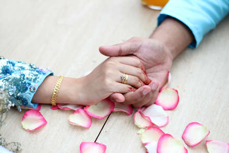 Bride holds hands Stock Photo