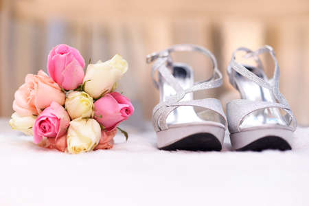 Bouquet with wedding shoes