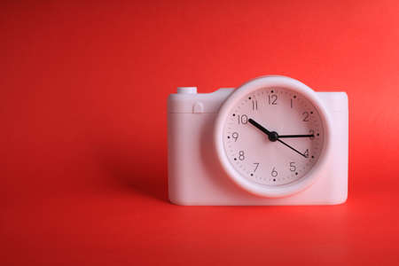 analog clock on red background
