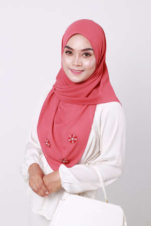Beautiful asian muslim woman wearing hijab posing on studio isolated on white background