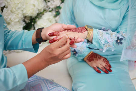 Bride and groom put a ring. beautiful and unique henna