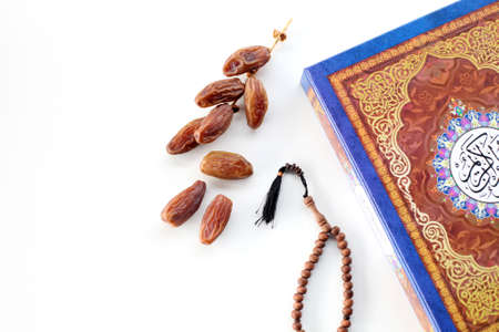 amadan kereem with holy quran, dates and rosary isolated on white background