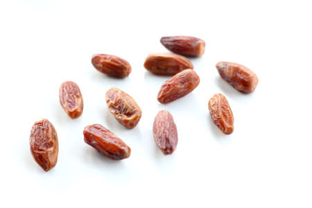 Dates fruit on white background.selective focus