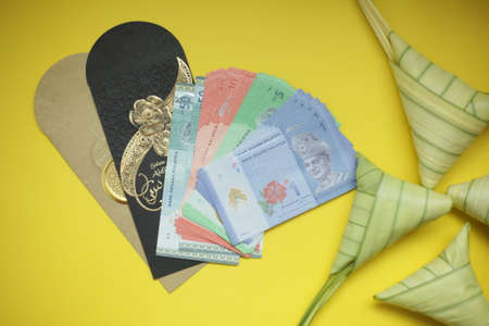 Ketupat or Rice dumpling with pocket money envelop for Hari Raya Idul Fitri concept. top view Imagens