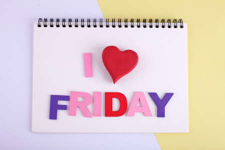 I LOVE FRIDAY word concept writing by by wooden block Imagens