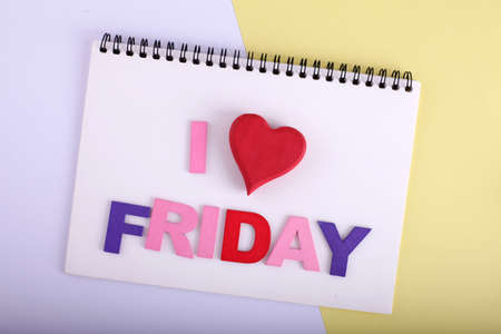 i love FRIDAY word concept writing by by wooden block