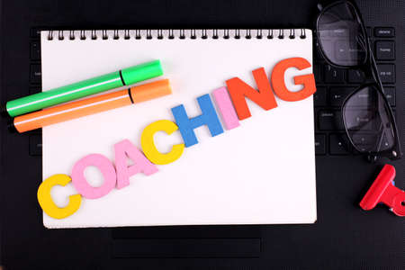 COACHING word concept writing by wooden block