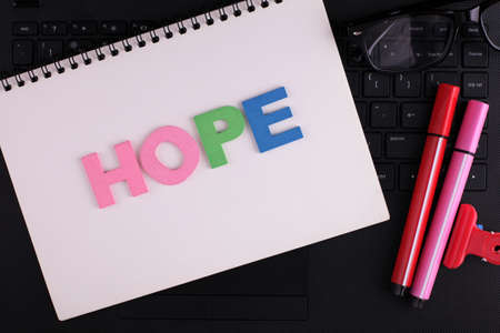 HOPE word concept writing by wooden block