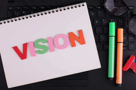 VISION word concept writing by wooden block