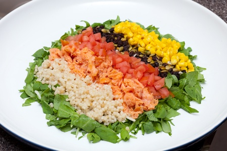 Refreshing colorful vegetable and fish salad  photo
