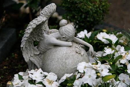 Angel weeping at gravestone